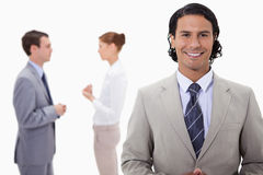 Businessman with talking colleagues behind him Stock Photo