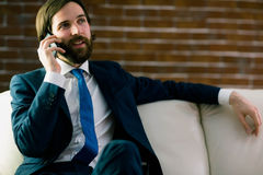 Businessman talking on the couch Royalty Free Stock Photo