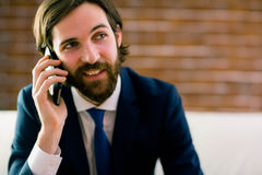 Businessman talking on the couch Stock Image