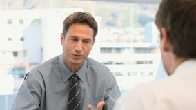 Businessman talking with a customer Stock Photography