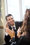 Businessman talking with female Hispanic coworker Royalty Free Stock Images