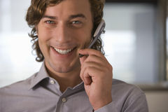 Businessman talking on hands-free headset Royalty Free Stock Images