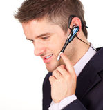 Businessman talking on a headset Royalty Free Stock Image