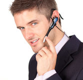 Businessman talking on a headset Royalty Free Stock Images