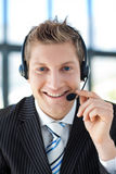 Businessman talking on a headset Stock Photos
