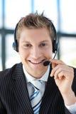 Businessman talking on a headset Stock Photos