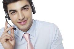 Businessman talking on headset Royalty Free Stock Photo