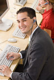 Businessman talking on headsets Stock Photos