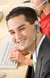 Businessman talking on headsets Stock Photography