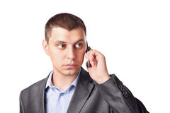 Businessman talking on his cell mobile phone Royalty Free Stock Photography
