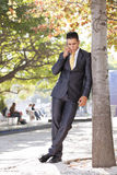 Businessman talking at his cellphone Royalty Free Stock Photo