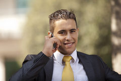 Businessman talking at his cellphone Royalty Free Stock Images