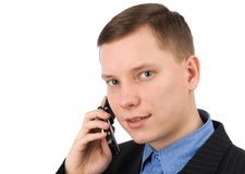 Businessman talking on his mobile phone Stock Photos