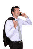 Businessman talking on his mobile. Phone Stock Image