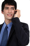 Businessman talking on his mobile Royalty Free Stock Images