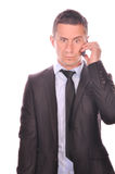 Businessman talking on his smartphone Royalty Free Stock Photos