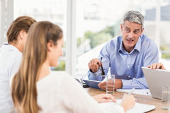 Businessman talking while meeting Stock Image