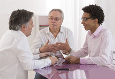 Businessman talking at a meeting- recruitment review Stock Photography