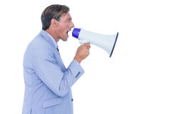 Businessman talking through megaphone Stock Photos