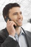 Businessman talking on mobile. Closeup portrait of happy businessman talking on mobile in office lobby Stock Image