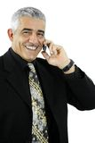 Businessman talking on mobile. Portrait of happy mature businessman talking on mobile phone, smiling. Isolated on white Royalty Free Stock Photos