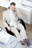 Businessman talking on mobile Royalty Free Stock Images