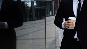 Businessman talking on mobile phone. Urban male drinking coffee outdoor. Businessman talking on mobile cell phone in city wearing suit in city business district stock video footage
