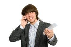 Businessman talking on mobile emotionally Stock Photo