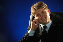 The businessman talking by a mobile phone Royalty Free Stock Photos