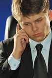 The businessman talking by a mobile phone Royalty Free Stock Photo