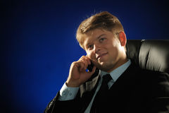 The businessman talking by a mobile phone Royalty Free Stock Image