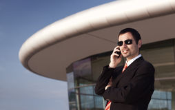 Businessman talking on mobile phone. Royalty Free Stock Images