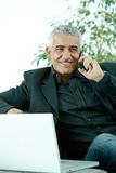 Businessman talking on mobile phone Stock Image