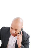 Businessman talking on mobile phone Stock Photos