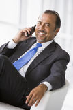 Businessman talking on mobile phone. In lobby Stock Photography