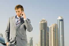 A businessman talking on a mobile phone Stock Image