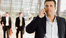 Businessman talking on mobile phone stock photography