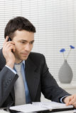 Businessman talking on mobile phone Stock Images