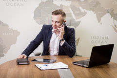 A businessman talking on a mobile phone,Businessman talking on t Royalty Free Stock Photos