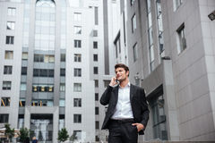 Businessman talking on mobile phone in the city Stock Photo