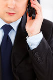 Businessman talking on mobile phone. Close-up. Royalty Free Stock Photography