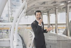 Businessman talking on mobile phone. Handsome businessman talking on mobile phone Royalty Free Stock Photography