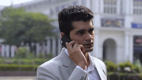 Businessman talking on a mobile phone stock footage