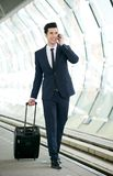 Businessman talking on mobile phone at metro station Stock Photography