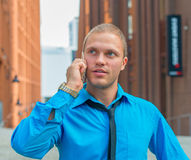 Businessman talking on the mobile phone. Stock Photo
