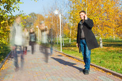 Businessman talking on mobile phone in the park Stock Image