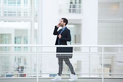 Businessman talking on mobile phone Royalty Free Stock Images
