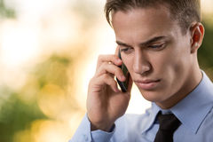 Businessman talking over cellphone Stock Photo
