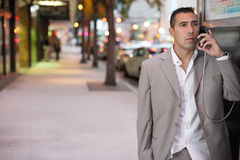 Businessman talking on a payphone royalty free stock images