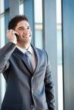 Businessman talking on phone Royalty Free Stock Image
